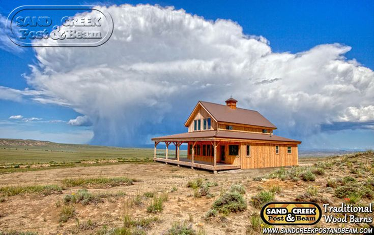 sandcreekpostandbeam.com A storm cloud grows over one of our post and beam barn homes located out west!