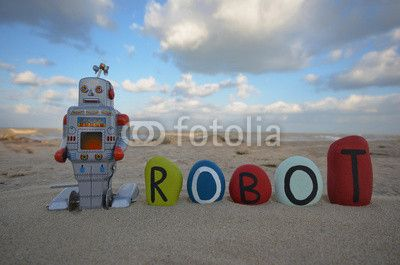 Tin toy robot concept with name on colored stones