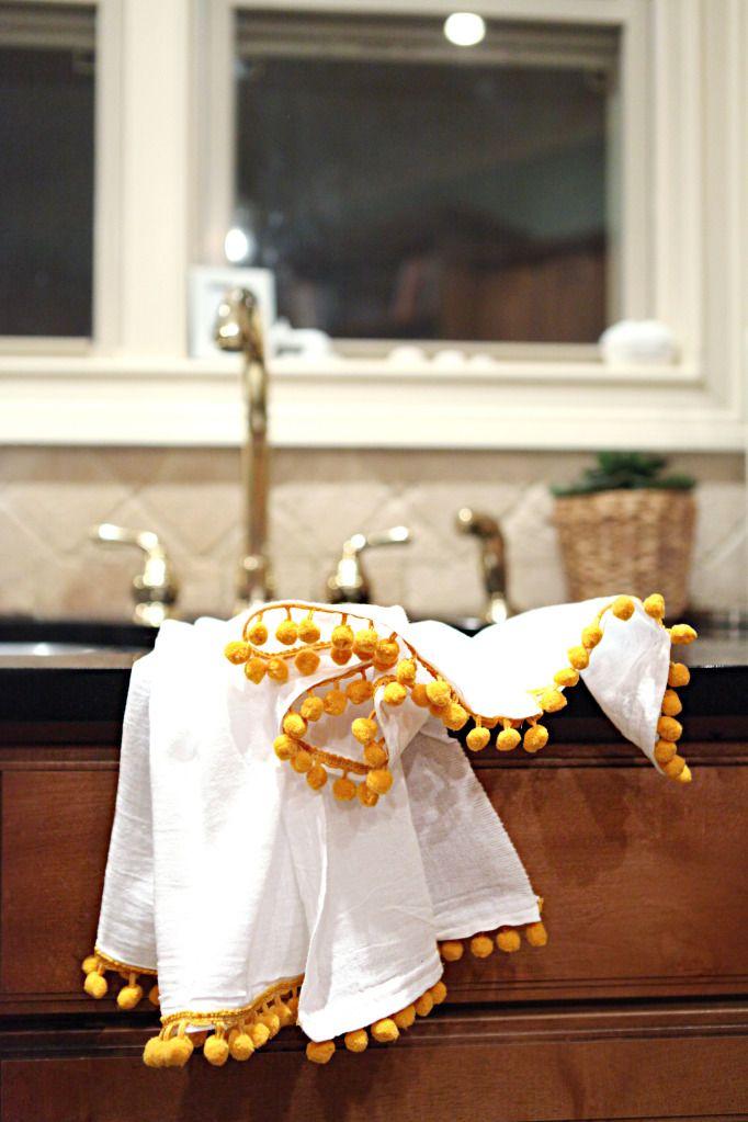 Sew pompoms to flour sack towels- so cute!