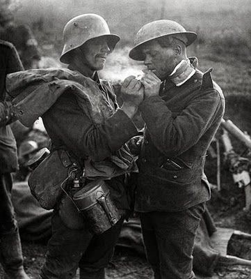 WWI British and German soldiers exchange cigarettes, gifts, and addresses during Christmas Truce, 1914