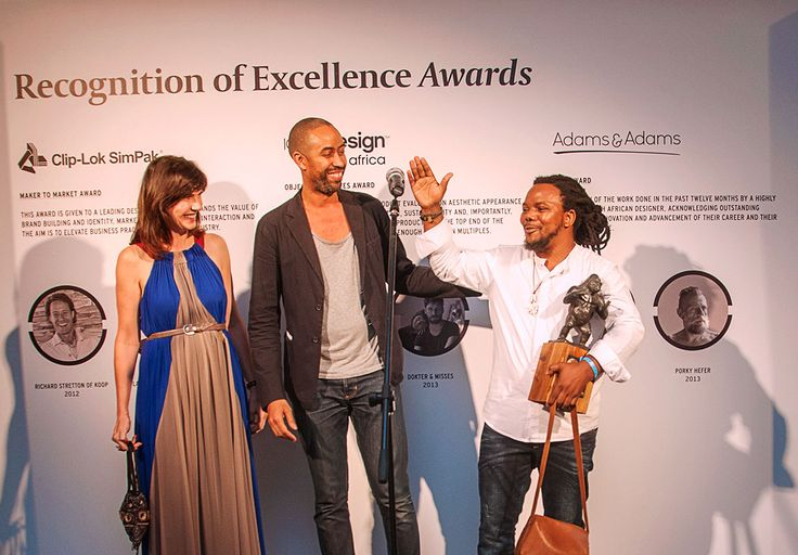 Andile Dyalvane, winner of the Icon Award, is congratulated by Mariette du Plessis of Adams & Adams, and Stephen Burks