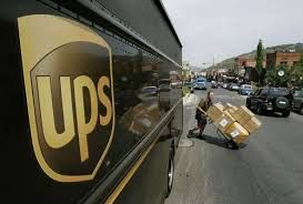 UPS delivery truck and parcels being delivered