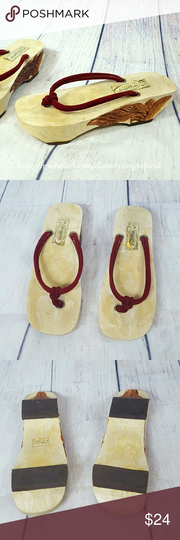 """VINTAGE 70s Faux Wood Platform Flip Flops 9 VINTAGE 70s Faux Wood Platform Flip Flops size 9. Very unique. They feel like a wood composite material. Like new. These seem to fit more like a size 8.5. Please check the measurements. Measures 2"""" high, 10"""" long, 3.5"""" wide.  Please let me know if you have any questions. Happy Poshing! Vintage Shoes Sandals"""
