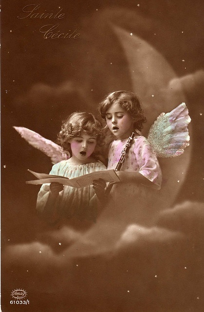 "Vintage tinted postcard with two little ""angels"" with a moon in the backgroud"