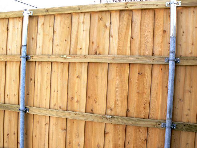 Wood Fence Utilizing Existing Metal Poles Fence Ideas