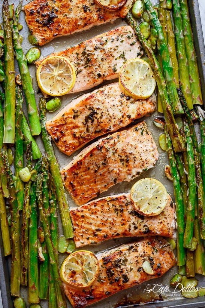 Lemon, garlic and parsley are infused in One Pan Lemon Garlic Baked Salmon + Asparagus ready in only 10 minutes without any marinading! | http://cafedelites.com