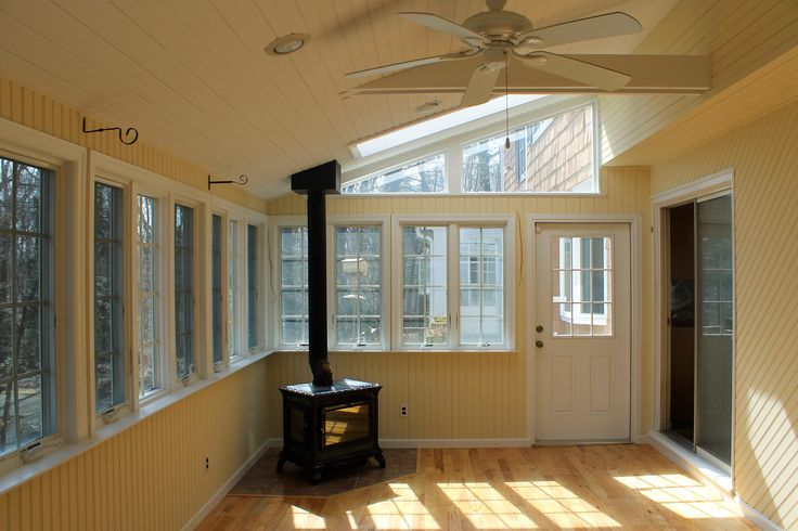 beautiful sunroom with a working wood burning stove that produces enough heat for the entire down stairs.