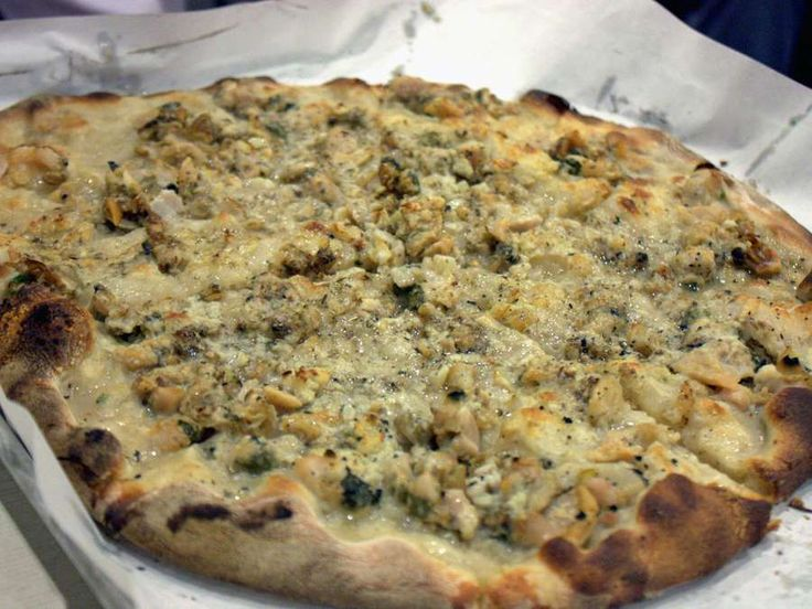 50 trips everyone should take in the US:    Scarf down a white clam pie with friends at Frank Pepe Pizzeria Napoletana in New Haven, Connecticut.