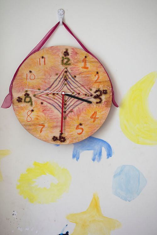 A homemade clock on the wall in the bedroom of Zhu Ding. Chengdu Waldorf School. The biggest and first fully licensed Waldorf school in mainland China.  Chengdu city, China.