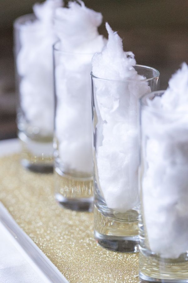 Sugar and Charm: Cotton Candy Shots. Put some cotton candy in a shot glass, then cover it with marshmallow vodka. It melts instantly for a super sweet shot.