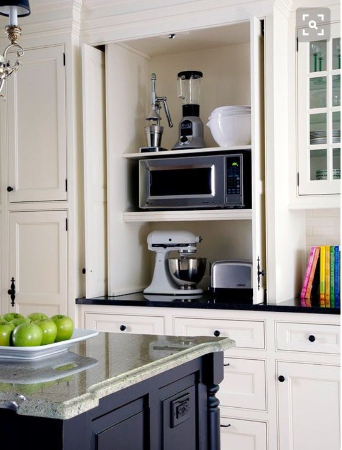 Best 25 appliance garage ideas on pinterest diy hidden kitchen appliances appliance cabinet - Retractable kitchen cabinet doors ...