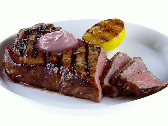 Get this all-star, easy-to-follow NY Strip Steak with Red Wine-Rosemary Butter recipe from Giada De Laurentiis.