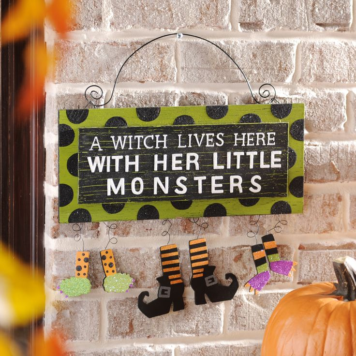 a witch her little monsters wall sign