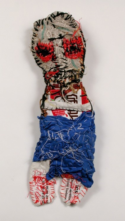 the shamanistic art of Michel Nedjar. http://www.jsaslowgallery.com/artists/nedjar/mn_1692_72dpi.jpg