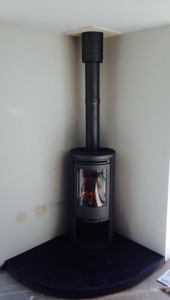 Nice Contura Freestanding stove fitted recently on a smooth, curved slate hearth..