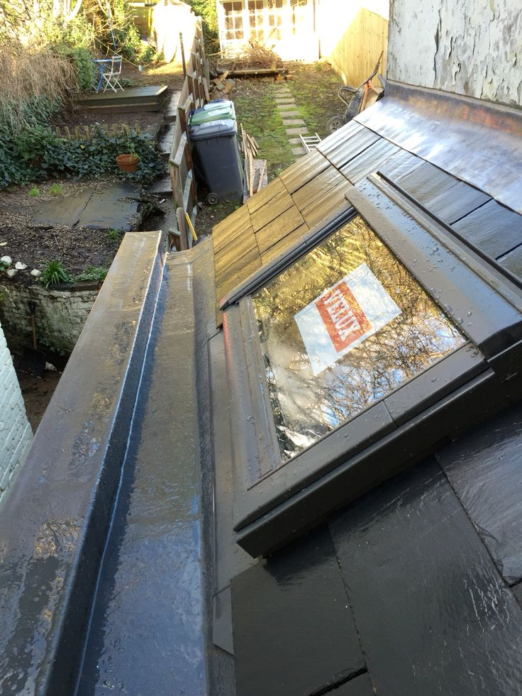 Small slated roof with Velux window and GRP box gutter