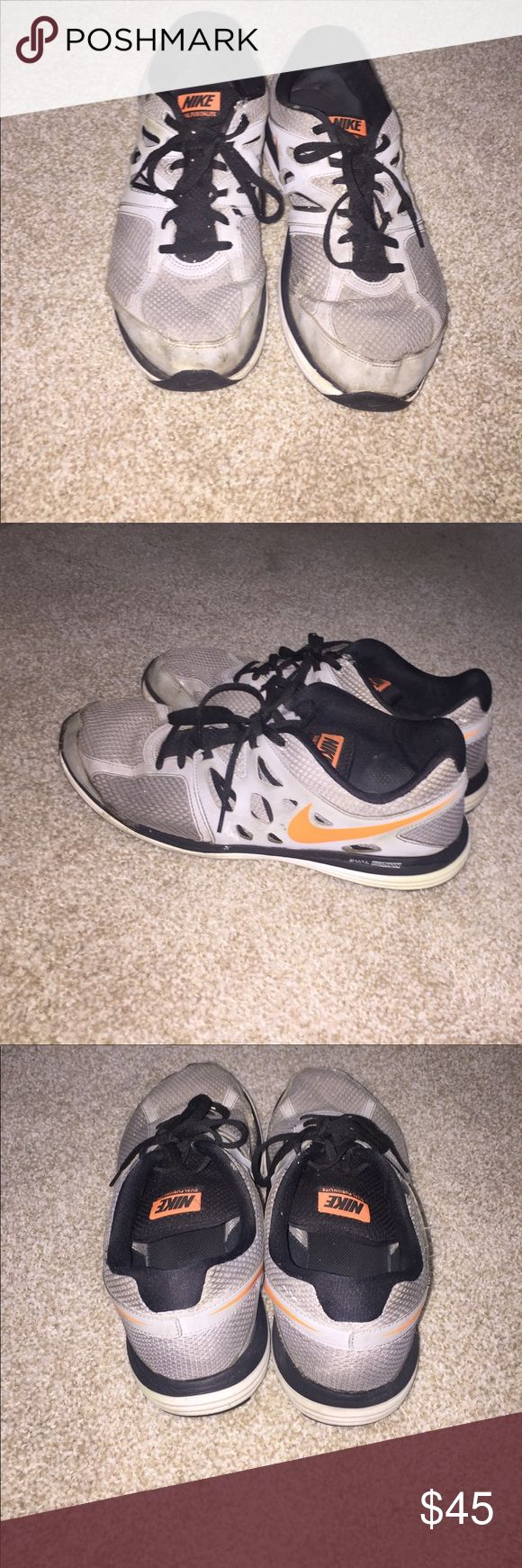 Nike Dual Fusion Lite Gently worn gray and orange Nike shoes with some scuffs and marks on the outside back part. Has mesh lining for easy stretch and breathable material for the summer wear. Still in great condition! Nike Shoes Sneakers