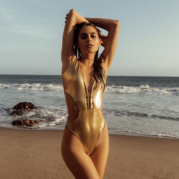 Kendall + Kylie bring serious party appeal to the all-in-one swimsuit for the summer. Cut-out details are key – think a plunging neckline and flashes of skin to the cut-away mid-section. Crafted in an all-over metallic gold, it comes detailed with an intricate barbell fastening and a high-cut leg line to accentuate your shape. #Topshop