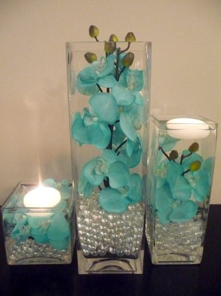 Pretty center piece idea :) this is my color! H - Pretty center piece idea :) this is my color!    Hand painted teal orchids used in both Ceremony and in reception. Long multi stems work best in these vases. Rent in the Savannah/ Hilton Head area for