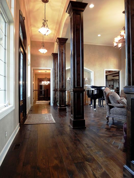 Stone And Wood Make A Dark Masculine Interior: Columns. Keep The Hallway From Dinginess And Give The