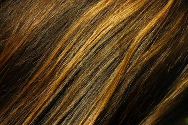 Highlighting and lowlighting your hair gives dimension to your natural hair color without having to dye all of your hair. Highlights use peroxide or bleach to strip the hair of its natural color creating anywhere from an orange to white blond. Lowlights deposit colors like brown, black, auburn or eggplant. A popular at-home highlighting method …