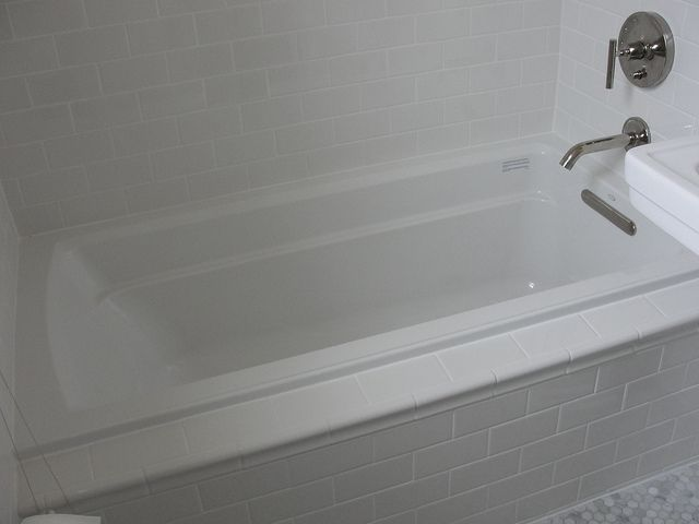 Kohler Archer Drop-In Tub with Daltile Subway Tile in Kohler White 2 by onestorybuilding, via Flickr