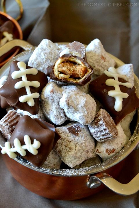 These Pretzel Football Muddy Buddies are INSANELY GOOD! Chocolate-covered peanut butter-filled pretzels are tossed with powdered sugar and peanut butter cups and decorated to look like mini footballs! Perfect for game-day!