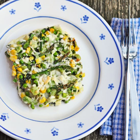 This Summer Veggies Lasagne redo is based on one of Jaimie Oliver's Meals in Minutes recipes and is loaded with asparagus, corn, fava beans, and mixed veggies along with cottage cheese, grated cheese, fresh herbs, and pasta.  Fabulous!