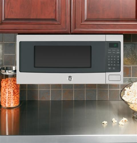 GE Profile space-saver cabinet-depth microwave, with optional under cabinet hanging kit. 1.1 cu ft, 800 watts.