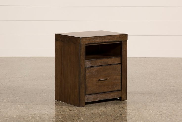 Our Riley nightstand will add plenty of character and order to your bedroom. Crafted of hardwood and veneer, the handsome, streamlined piece features a brownstone finish, aged bronze hardware and a media cutout for easy, clean electronics storage.