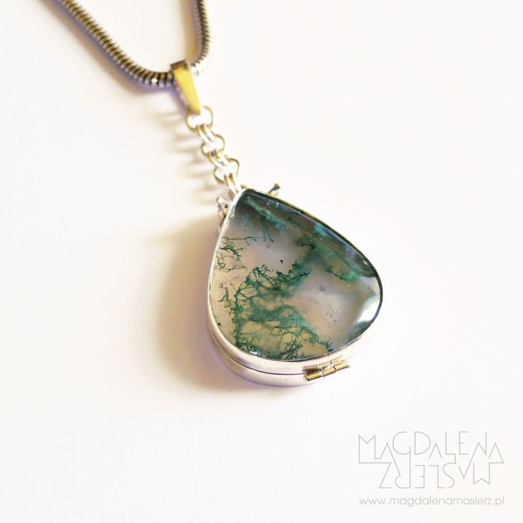 magdalena maślerz - it's a locket with moss agate cabochon cut in drop shape. you can hide something flat or a photo inside. the agate is semi-opaque so the color and pattern on the thing inside changes how the …