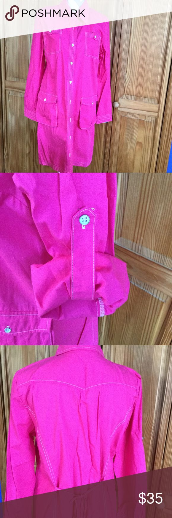 Pink Shirt Dress Pink dress shirt, rolled sleeves, contrast neck lining, ties in the back. 21 inches at the chest/armpit when buttoned and laid flat. 37 inches from shoulder to hem. Spanner Dresses