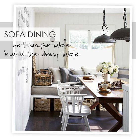 Dining room banquette. Love the rustic elements: baskets, farmhouse-style chairs, fresh flowers.