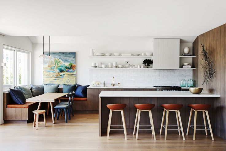 """Easy good style is what this home is all about. """"It's comfortable and contemporary, but also classic and elegant,"""" says Justine. """"It's a city home, but you don't feel you need to wear shoes,"""" adds Ben. A banquette, designed by Justine, creates a cosy family nook at one side of the kitchen and open-plan living area.   Hay About A Stool (AAS 32) **stools** from [Cult](http://www.cultdesign.com.au/