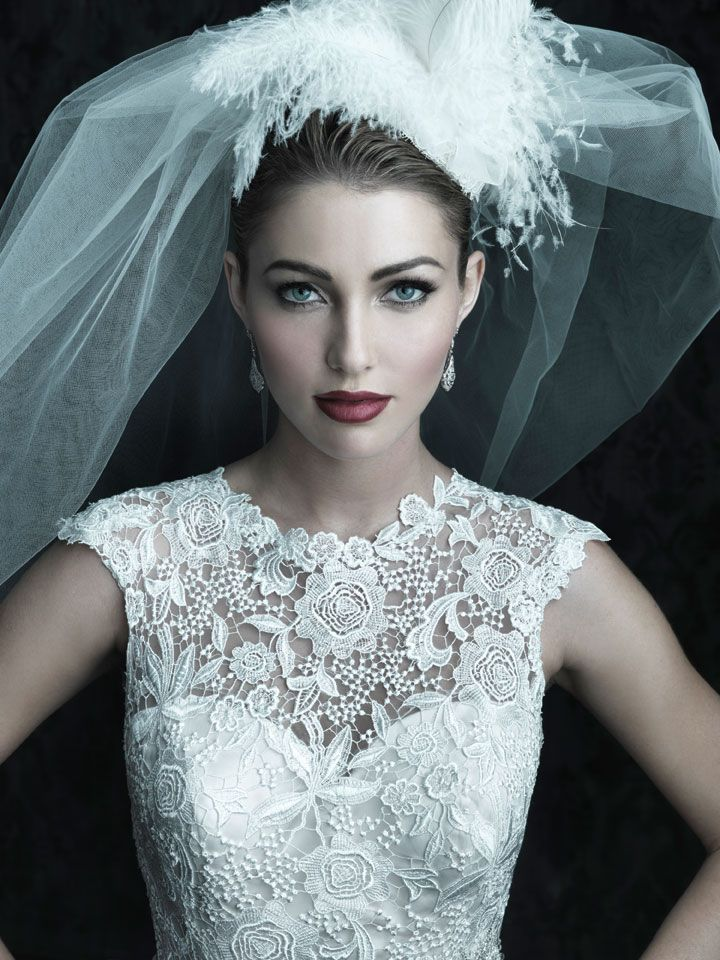 Allure Couture C226 - This fitted slim gown in all-over Venice lace features a beautiful raised neckline with a dramatic V-shaped back. A chapel length train and covered buttons complete this elegant style.  Vintage Style Bridal Gowns | Brides of Melbourne