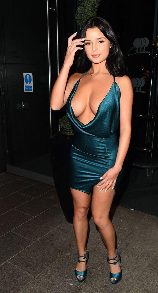 Demi Rose in Plunging turquoise Mini Dress