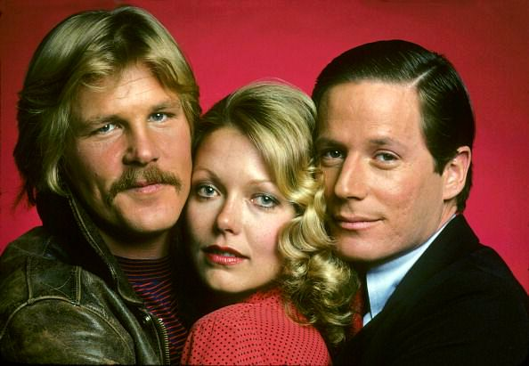 """Press photo of Susan with (l) actor Nick Nolte and (r) actor Peter Strauss for the TV mini-series """"Rich Man, Poor Man"""", 1976."""