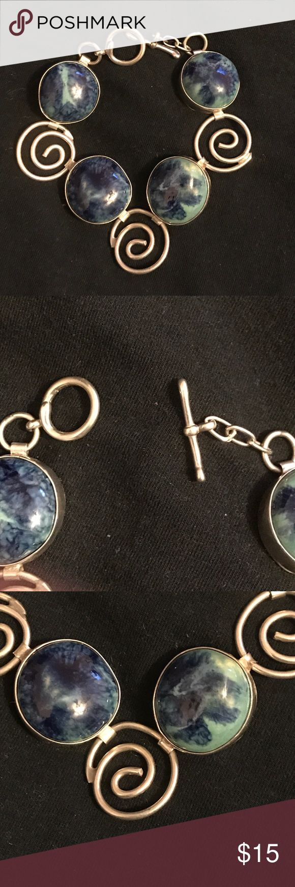 Metal and blue stone bracelet Metal and blue green stone bracelet. Initials on back are JLK (Unsure of the meaning of them but if you're initials happen to be JLK then this is your lucky day!) Great condition. Or best offer Jewelry Bracelets
