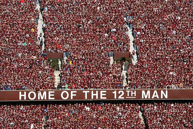 The 12th Man refers to our loyal Aggie fans.  It started in 1922 when a student was called out of the stands to play in a football game.  He stood on the sidelines for the rest of the game ready to go in.  Now, all Aggie students stand during our games to symbolize their 12th Man spirit!: Aggie Stuff, Favorite Places, Things Texas, 12Th Men, Kyle Fields, A M Aggie, Gig Ems, Texas A M, Aggie Football