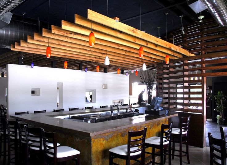 Modern bar interior design with wood slat walls devider