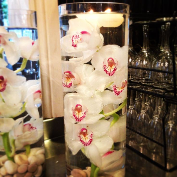 Getting the large orchid flower centrepieces ready for Paige & Daniel's wedding - March 14.  We love submerged flowers! See more at: http://standrewsconservatory.com.au/paige-daniel-8-march-2014/