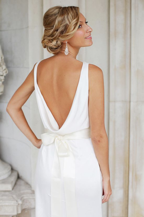 Love this loosely-draped back. Casually chic wedding dress