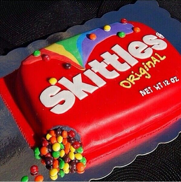 A cake made of skittles♡♥♡ YUMM.