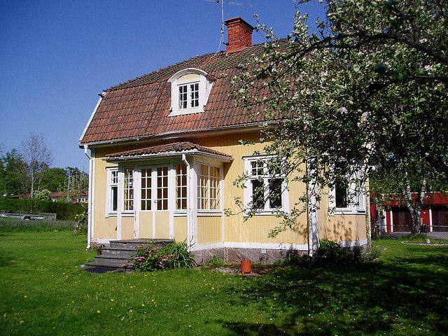 "My Swedish house: rear view with ""glasveranda"". Mullhyttan, Närke 2007 by victorious felines, via Flickr"