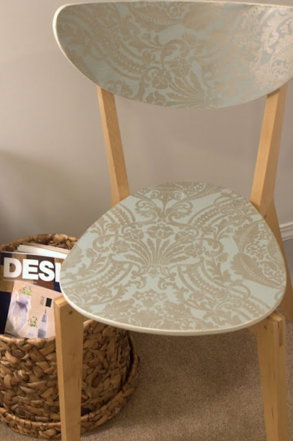 cut pieces of leftover wallpaper to size for the seat and back, and used spray adhesive and then covered in a glaze just to make sure the edges don't fray.