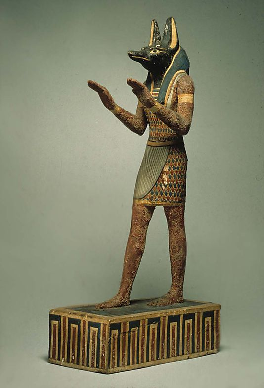 "Statuette of Anubis. Wood, gesso, paint. 332-30 B.C. ""Book of the Dead""? What was Moses aware of? Don't live for death like Egypt?"
