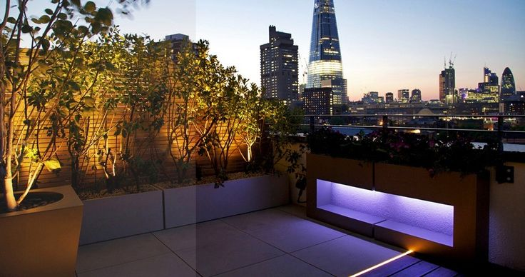 Dim Lighting Rooftop Garden Ideas With Compact Concrete Plus Internal Lamp And Big Tiles Flooring.