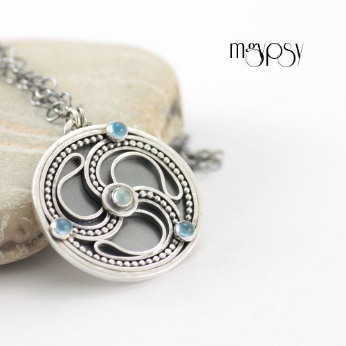 MGYPSY - Uisce Celtic inspired medallion made in sterling silver, adorned with blue topazes.