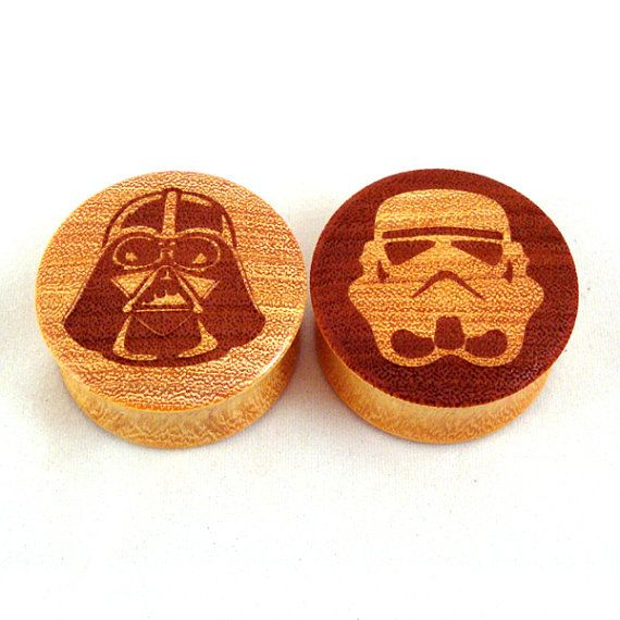 "Star Wars Plugs! Astral Wooden Plugs - 0g (8mm) 00g (9mm) (10mm) 7/16"" (11mm) 1/2"" (13mm) 9/16"" (14mm) 5/8"" (16mm) 11/16"" 3/4"" 7/8"" 1"" 1 1/8"" 1 1/4"". $34.00, via Etsy."