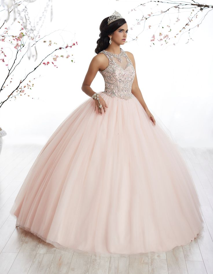Dance the night away in this beaded illusion A-line dress by Fiesta Gowns House of Wu Style Number 56327 during your Quinceanera, Sweet 16 party, or for any formal event. This ball gown features a fin